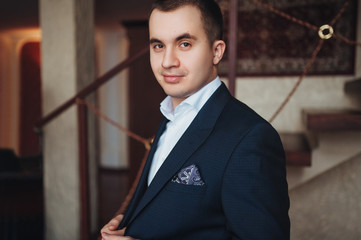 A young handsome Ossetian man dresses a suit.