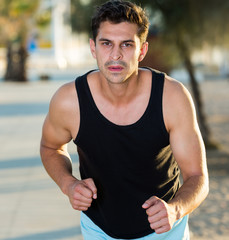 Man jogging on city seafront