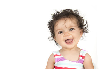 Smiling baby girl in striped shirt with white background