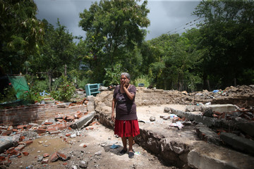 Ricarda Herrera, 60, poses for a photo at the ruins of her house after an earthquake in San Juan Pilcaya, at the epicenter zone