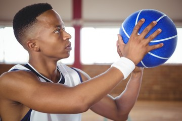 Close up of teenager practicing basketball