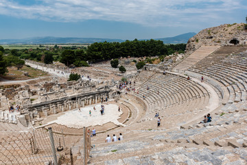 People visit Amphitheatre (Coliseum) at Ephesus historical ancient city, in Selcuk.High Resolution panoramic view.Izmir,Turkey:20 August 2017