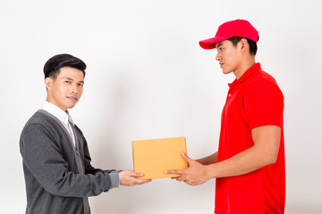 Man accepting a delivery of boxes from delivery service courier. Isolated on a White Background.