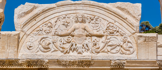 Marble reliefs in Ephesus historical ancient city, in Selcuk,Izmir,Turkey.Figure of Medusa with ornaments of Acanthus leaves,Detail of the Temple of Hadrian.