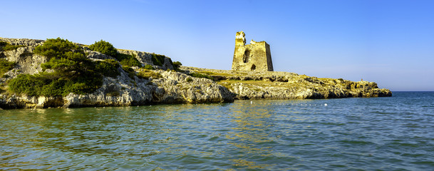 Panoramic view of the Gargano Coast. The ruin of an ancient watchtower to counteract the attack of Turkish ships. Apulia - Italy