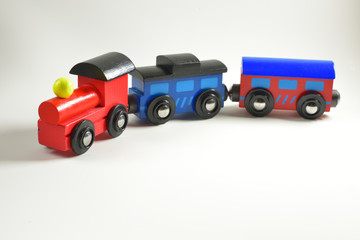 Wooden toy train with colorful blocs isolated on white background.