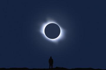 Man watching total eclipse