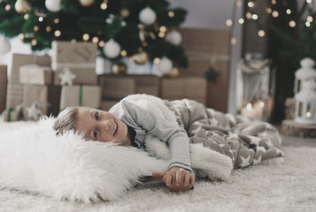 Boy lying on rug in living room