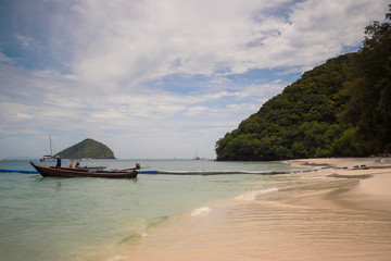 Phuket Islands a fishing boat moored near the beach with white sand Andaman Sea