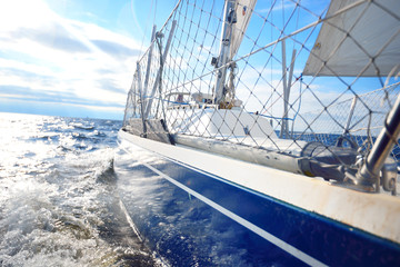 View from the deck of a sailboat close to the surface of the sea with waves