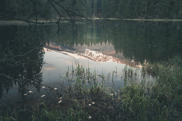 Vintage style photo of misty mountain lake