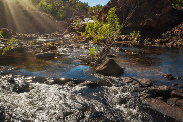 Sun rays at Edith Falls in the Nitmiluk National Park, Northern Territory, Australia.