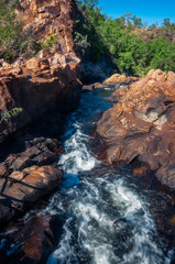 The creek flowing in between rocks at Edith Falls, Katherine, Australia.