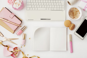 woman's modern workspace with notebook. flat lay