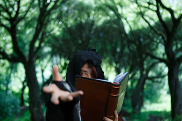 Photo of witch with magic book