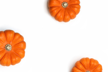 Autumn frame made of orange pumpkins isolated on white background. Fall, Halloween and Thanksgiving concept. Styled stock flat lay photography. Top view. Empty space for your text.