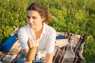Attractive girl sitting outside and flirting