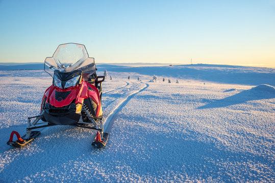 Snowmobile in a snowy landscape in Lapland, near Saariselka, Finland