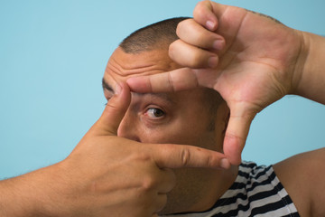 man making frame hand