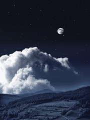 Night landscape with clouds and the full moon