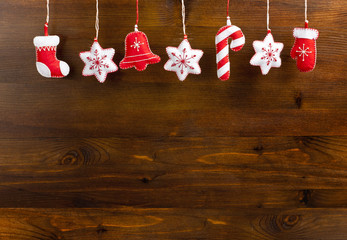 Hanging Christmas and New Year decorations on a wooden background.