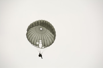Parachute soldiers in the sky.