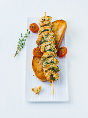 Skewer with fried shrimps
