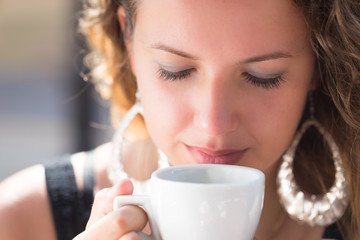 young woman portrait , drinking coffee in cafe outdoor in summer
