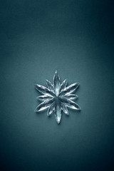 Silver Christmas Decoration on dark Paper Background