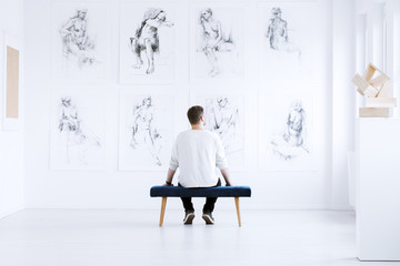Man relaxing in art gallery