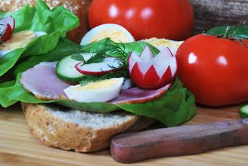 sandwich with radish ham and egg salad on a dietetic breakfast