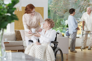 Nurse handing in white cup
