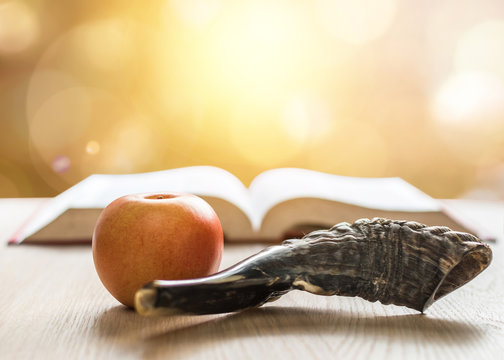 Yom Kippur, Rosh Hashanah (Hashana) jewish New Year, Shemini Atzeret (Shmini Atzeret) and Simchat Torah holiday concept with shofar traditional Israel's ram horn, apple with religious holy prayer book