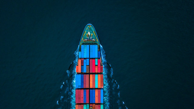 Aerial view container ship or cargo ship in import export and business logistic to global city.