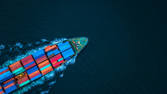 Aerial view from drone, Container ship or cargo shipping business logistic import and export freight transportation by container ship in open sea, Container loading cargo freight ship boat.