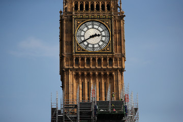 Scaffolders work on the Big Ben clock tower which is undergoing maintenance in Westminster, London