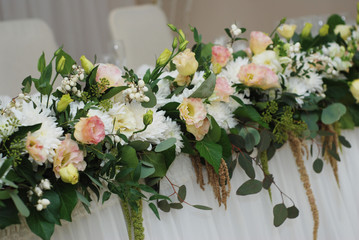 Decoration of Wedding table with Flowers.