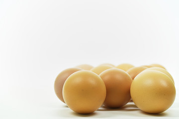 Fresh eggs on white background with copy space. Easter photo concept
