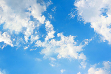 The vast blue sky and clouds sky in landscape view. White fluffy clouds in clean blue sky.