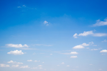 Beautiful blue sky with a small group of clouds background.