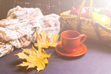 Cup of tea surrounded by autumn leaves. Autumn concept