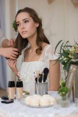 Young bride preparing for wedding