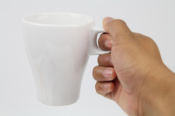 Hand Holding a White Cup Isolated White background