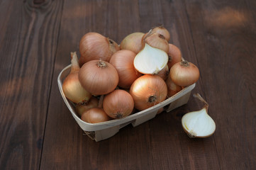 onion on a wooden table in a basket