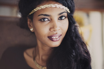 portrait of beautiful happy black young woman posing