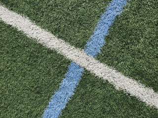 Colorful boundary lines on artificial turf sports field