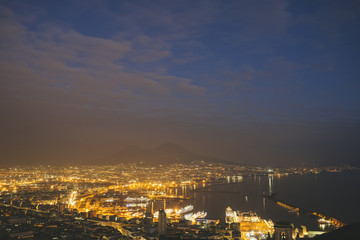 Twilight over Naples, Italy and Vesuvius in the background