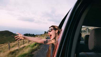 woman getting the head out of the car window