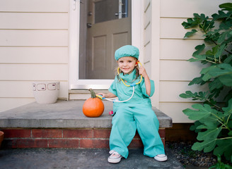 little girl dressed up as doctor