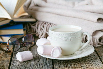 Cozy breakfast with warm plait and hot tea with milk